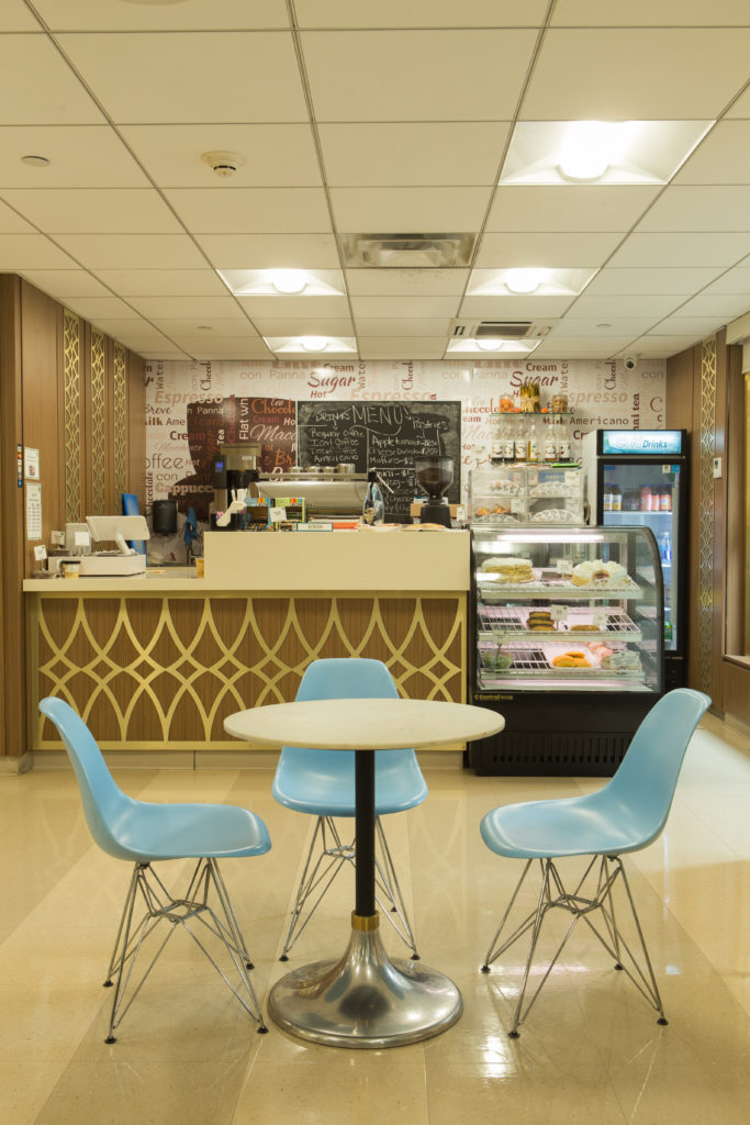 The Upper East Side Rehabilitation and Nursing Center coffee shop. There is fresh coffee and dessert and a table in the foreground.