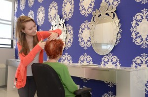 woman gets her hair cut by stylist