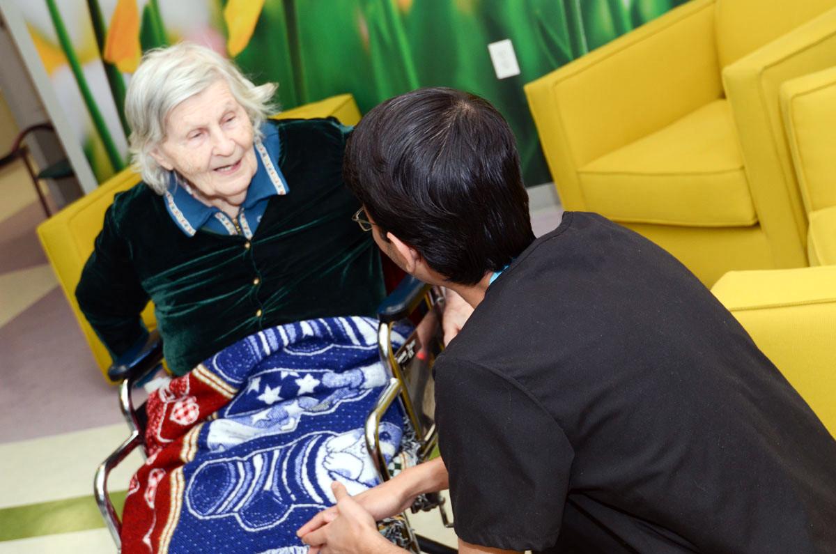 Woman talking to elderly patient